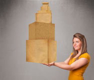 Young lady holding a set of brown cardboard boxes Stock Photography