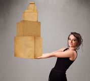Young lady holding a set of brown cardboard boxes Stock Photo
