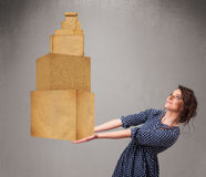 Young lady holding a set of brown cardboard boxes Royalty Free Stock Images