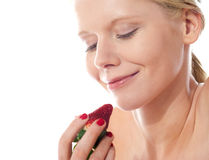 Young lady holding a strawberry Stock Image