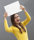 Young lady holding up blank board for your commercial royalty free stock image