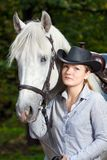 Young Lady hugging her horse Stock Images
