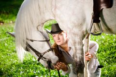 Young Lady hugging her horse Royalty Free Stock Photo