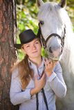Young Lady hugging her horse Royalty Free Stock Image