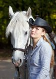 Young Lady hugging her horse Royalty Free Stock Images