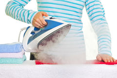 Young lady ironing her clothes Royalty Free Stock Images