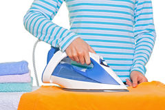 Young lady ironing her clothes Stock Image