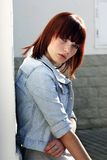 Young lady in jacket near wall [06] Royalty Free Stock Photos