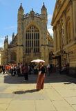 Young lady in Jane Austin style dress in front of the Bath Abbey Stock Photography
