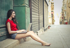 Young lady with laptop Stock Images