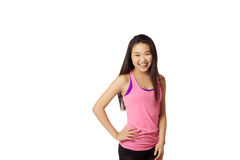 Young Lady Laughing. Half body portrait of asian american girl laughing in studio on white background wearing casual athletic clothing (pink Stock Photography