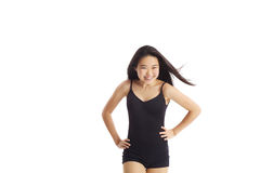 Young Lady Laughing. Half body portrait of asian american girl laughing in studio on white background wearing a classic ballet leotard and shorts Stock Image