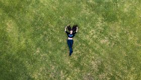 Young lady laying in the grass. Unam botanico mexico city stock images
