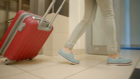 Young Lady Leaving Elevator and Building to the Street with Suitcase and Bag. Young Slender Lady Tourist Leaving the Elevator and then the Building Out to the stock video footage