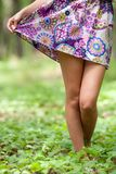 Young lady legs in a forest Stock Photo