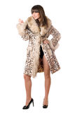 Young lady in leopard coat Royalty Free Stock Images