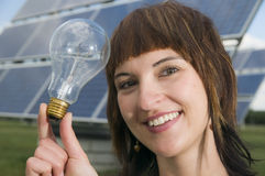 Young lady with light bulb Royalty Free Stock Images