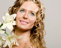 Young lady with lily flower Royalty Free Stock Photo