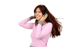 Young lady listening to music isolated Stock Images