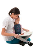 Young Lady and Little Girl Reading Book Together Stock Photography