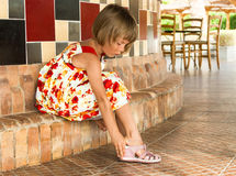 Young lady. Little girl wears pink sandals Royalty Free Stock Photos
