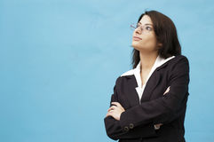 Young lady looking away. Young woman wearing eyeglasses and looking away Stock Photos