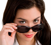 Young Lady Looking over Sunglasses Royalty Free Stock Photography