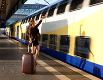 Young lady with luggage stop a train Stock Images