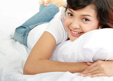 Young lady lying on the bed Stock Photos