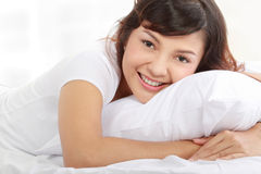 Young lady lying on the bed Royalty Free Stock Images