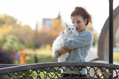 Young lady with Maine Coon cat Royalty Free Stock Photos