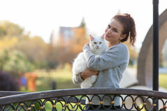 Young lady with Maine Coon cat Stock Photo