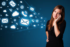 Young lady making phone call with message icons Royalty Free Stock Photography