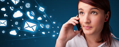 Young lady making phone call with message icons Royalty Free Stock Images
