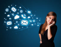 Young lady making phone call with message icons Royalty Free Stock Image