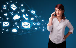 Young lady making phone call with message icons Stock Image