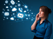 Young lady making phone call with message icons Stock Photos