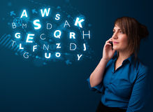 Young lady making phone call with shiny characters Stock Photo