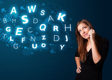 Young lady making phone call with shiny characters Royalty Free Stock Photo
