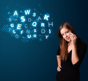 Young lady making phone call with shiny characters Royalty Free Stock Photography