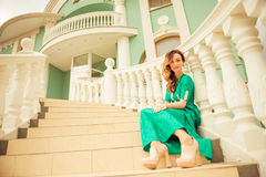 Young lady at mansion stairs Royalty Free Stock Photography