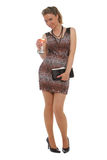 Young lady with a martini. Woman with a leopard print dress holding a martini glass Royalty Free Stock Photography
