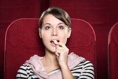 Young lady in the movie theater Stock Image