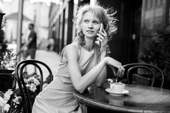 Young lady with mug of coffee at cafe stock photography
