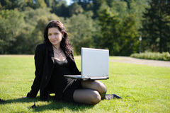 Young lady with a notebook in a park Stock Photos