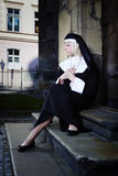 Young lady in nuns frock Stock Photo