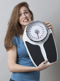 Young lady OH NO overweight Stock Photography