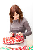 Young lady open boxes with presents Stock Photos