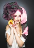Young lady with orchids Royalty Free Stock Photo
