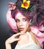 Young lady with orchids Stock Image